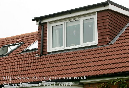 Dormer window with sloping roof