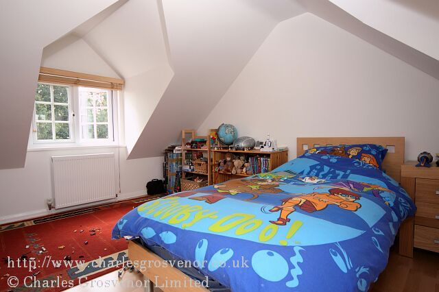 Childrens loft bedroom with large gable dormer