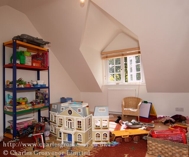 Loft conversion play room with dormer window