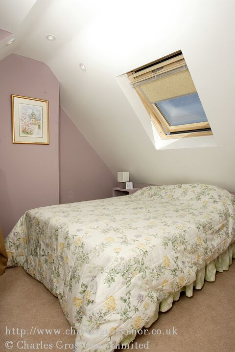 Single loft conversion bedroom with velux window