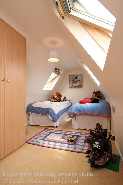 Childrens attic bedroom with velux roof windows - Two bedroom houses attic ...