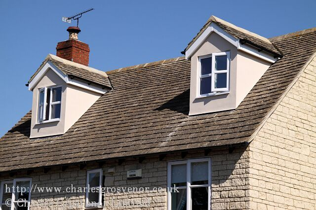 Loft conversion with rendered gable dormer