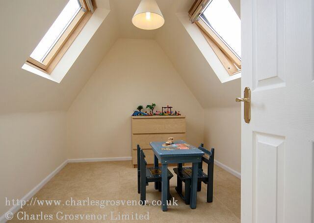 Childrens playroom with velux roof windows