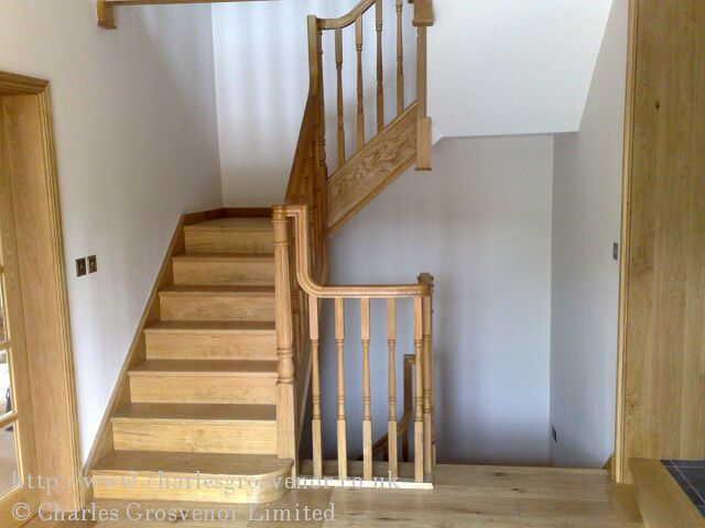 Oak staircase rising from existing landing with full risers for varnish finish.