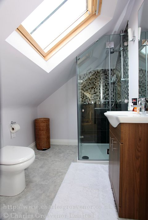 The shower room shows an ingenious design of fitting in a purpose made shower, toilet and basin in a fully functional room enhanced with a Velux rooflight.