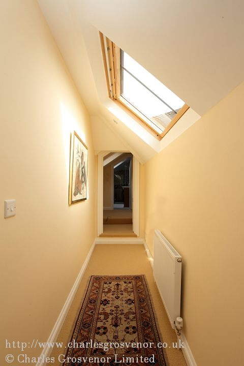 This hallway was existing but by fitting a rooflight this achieved a more spacious and open feel to its confined area.