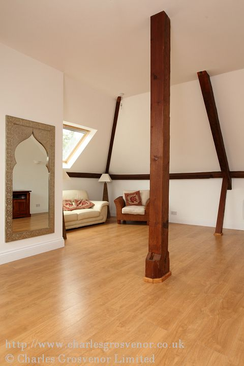 The photograph is clearly showing the exposed existing beams but due to the roof height the ceiling was lowered to give a more pleasing feel to the room.
