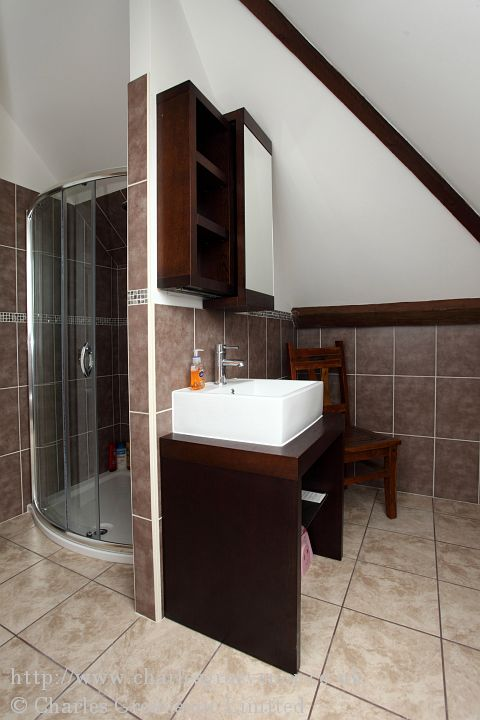The units chosen for this shower room compliment the exposed beams and valley blades.