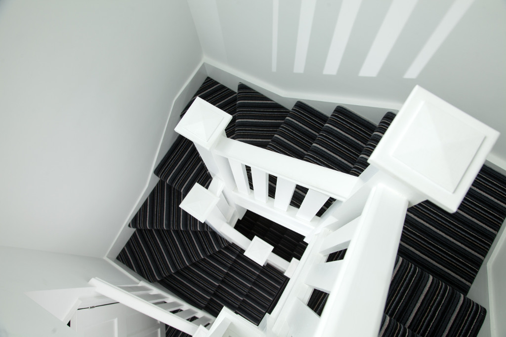 Triple turned staircase over the existing