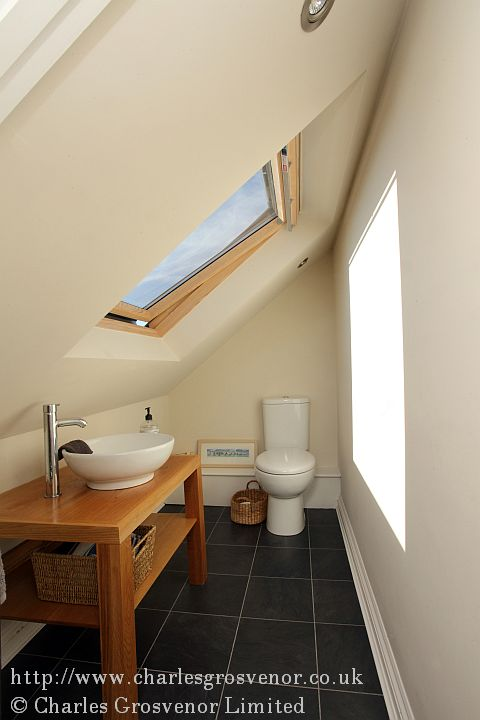 This shows a WC and basin fitted into a small space but totally functional.