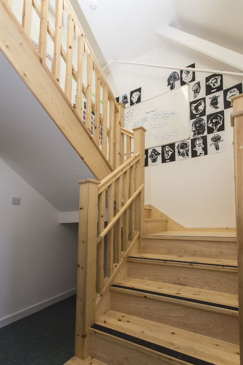 New staircase with lower handrail for children