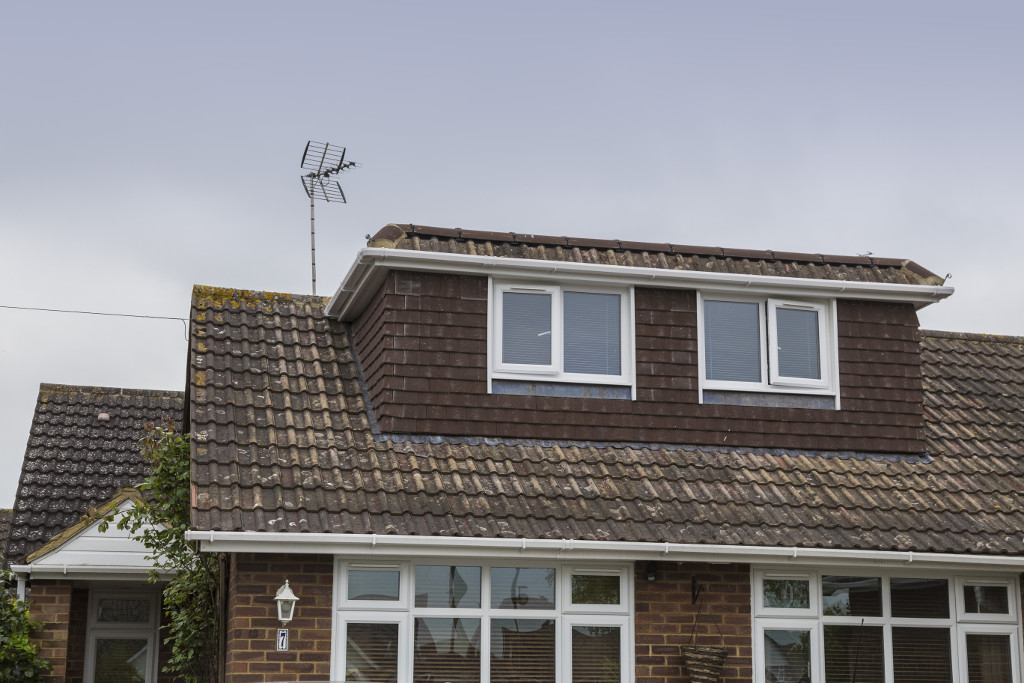 Dropped-eave dormer with matching tiles