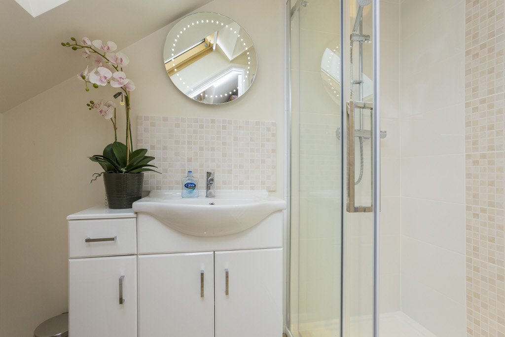 Compact shower room with large shower