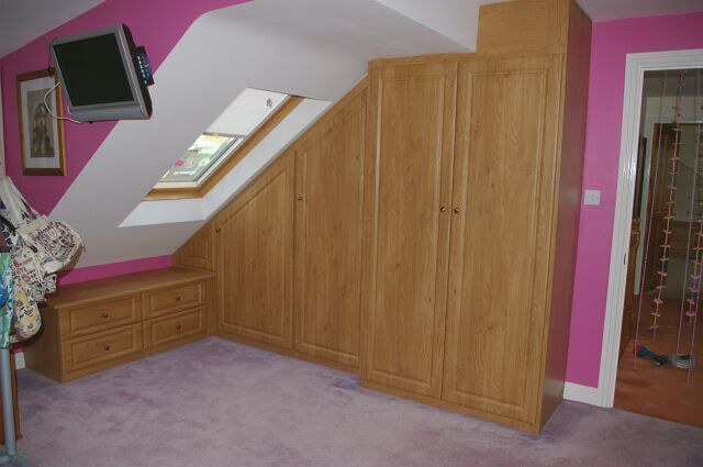 Bespoke wardrobe and low level drawer unit in oak fitted to loft conversion in Stratford upon Avon