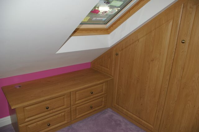 Bespoke oak unit fitted in loft conversion in Stratford upon Avon