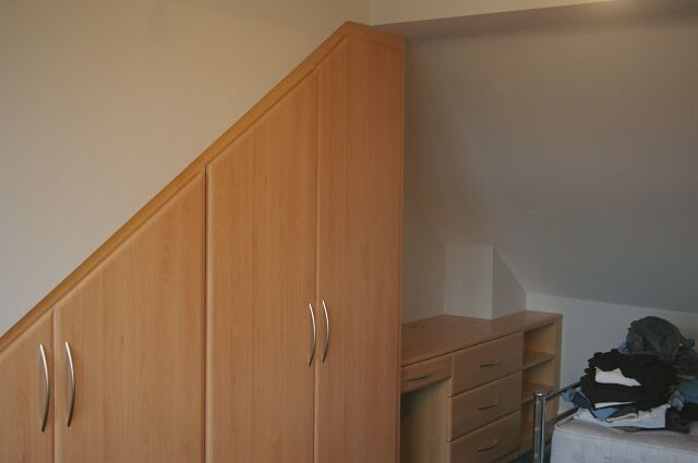 Bespoke angled wardrobe constructed under dormer cheek to loft conversion in Birmingham