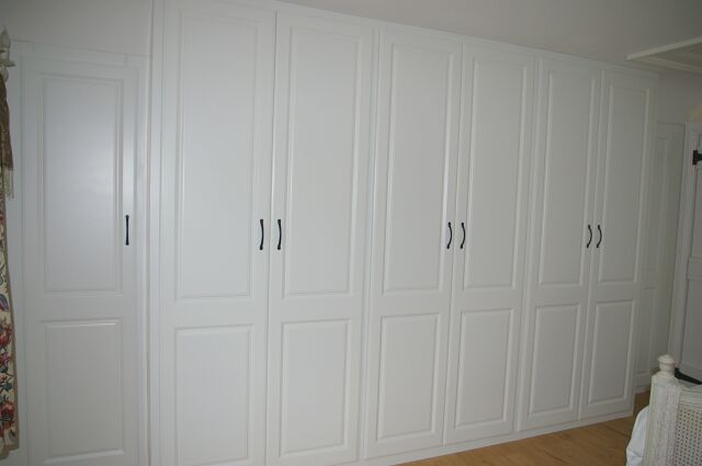 Bespoke fitted triple wardrobes in master bedroom in loft conversion in Newbury