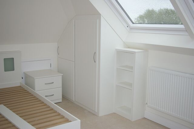Bespoke white gloss bedroom furniture in loft conversion in Abingdon