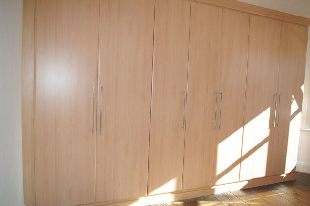 Bespoke triple wardrobe in loft conversion in Henley on Thames