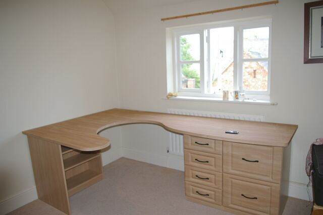Bespoke oak fitted desk in study area of loft conversion in Witney