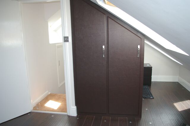 Bespoke Wenge finish angled wardrobe to loft conversion in Worcester
